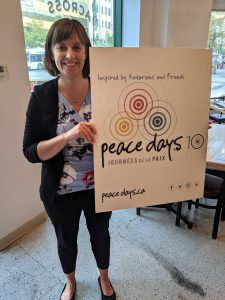 Michelle holds peace days promotional poster